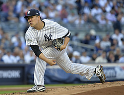 October 18, 2017 - Bronx, NY, USA - New York Yankees starting pitcher Masahiro Tanaka works against the Houston Astros in Game 5 of the American League Championship Series at Yankee Stadium in New York on Wednesday, Oct. 18, 2017. (Credit Image: © Howard Simmons/TNS via ZUMA Wire)