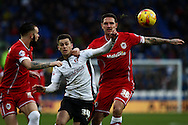 Tom Lawrence of Rotherham (centre) tussles with Sean Morrison (right) and John Brayford of Cardiff. Skybet football league championship match, Cardiff city v Rotherham Utd at the Cardiff city stadium in Cardiff, South Wales on Saturday 6th December 2014<br /> pic by Mark Hawkins, Andrew Orchard sports photography.