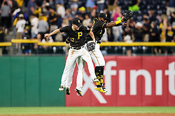 Jun 15, 2018; Pittsburgh, PA, USA; Pittsburgh Pirates left fielder Corey Dickerson (12) and Pittsburgh Pirates right fielder Gregory Polanco (25) and Pittsburgh Pirates center fielder Starling Marte (6) celebrate in the outfield after beating the Cincinnati Reds at PNC Park. Mandatory Credit: Ben Queen-USA TODAY Sports