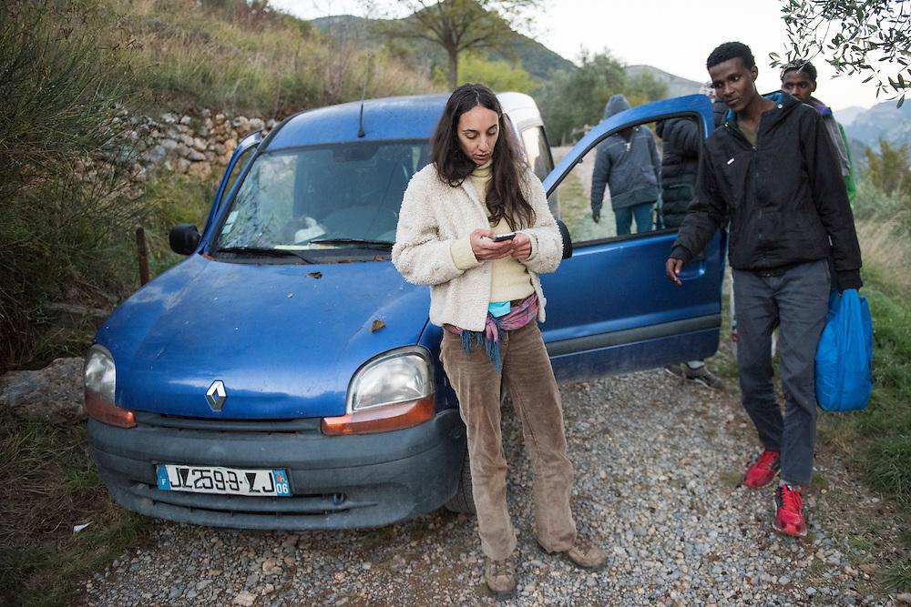 November 7, 2016 - Breil-sur-Roya, France: Eloise contacts the network of citizens who offer aid to migrants - she is one of the inhabitants of the Roya valley who help migrants. She found five Eritrean refugees walking on the road, she took them in her car, and will shelter them in her home for a night.<br /> <br /> 7 novembre 2016 - Breil-sur-Roya, France: Eloise contacte le réseau des citoyens qui aide des migrants - elle est une des habitantes de la vallée de la Roya qui aident des migrants. Elle a trouvé cinq réfugiés érythréens qui marchaient sur la route, et elle les a pris dans sa voiture pour les accueillir dans sa maison pour une nuit.