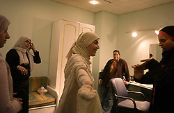 Mona Abdel-Ghani is seen preparing for her program on local television in Cairo, Egypt, Dec. 22, 2005. She is one of many hosts who now addresses social issues and their relation to Islam on the air. The director of her program helped Islamic televangelist Amr Khaled get his start. Khaled had previously been asked to leave Egypt as his revival gained strength. As a result he started preaching on several television shows, turning him into an international celebrity. Some religious scholars complain that Khaled has not been properly trained in Islam to command such a following.