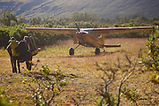Backpackers are picked up by a bush plane at the Skolai Pass backcountry airstrip in Wrangell-St. Elias National Park, Alaska.