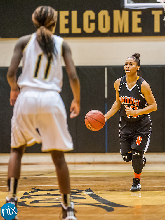Northwest Cabarrus' Shatiya Bost brings the ball down against Concord Tuesday night at Concord High School. Northwest Cabarrus won the game 38-21.