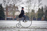 "© Licensed to London News Pictures. 18,03,2018. Surbiton, UK.  <br /> Families enjoy riding Penny Farthings in the snow in Surbiton today 18 March 2018. Locals were taking part in a project celebrating the Penny Farthing's maker, one time Surbiton resident and carpenter's apprentice John Keen, who became one of the most important pioneering figures in cycling history. He quit his carpentry career and dedicated himself to becoming the undisputed ""boneshaker"" racing champion of Britain. He could ride half a mile in 2 min 45 secs. Keen realised the ""boneshaker"" was heavy and cumbersome in design and went on to build something better - the ""ordinary bicycle"" - which later became known at the ""penny farthing"" Known as Happy Jack, Keen raced until he was 36, but his health failed and he faded into obscurity. He died in 1902.  Photo credit: Stephen Simpson/LNP"