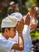 19 JULY 2016 - TAMPAKSIRING, GIANYAR, BALI, INDONESIA: Men pray on the first day of a ceremony to honor the anniversary Pura Agung temple, one of the most important Hindu temples on Bali. This year's ceremony is the most important in years because it falls on the 50 year cycle of the temple's founding. This year's ceremony lasts for 11 days.      PHOTO BY JACK KURTZ