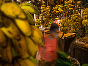 10 NOVEMBER 2014 - SITTWE, MYANMAR: A woman walks through the banana market in Sittwe, Myanmar. Sittwe is a small town in the Myanmar state of Rakhine, on the Bay of Bengal.    PHOTO BY JACK KURTZ