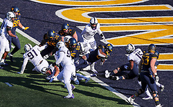 Nov 10, 2018; Morgantown, WV, USA; West Virginia Mountaineers running back Kennedy McKoy (6) runs for a touchdown during the third quarter against the TCU Horned Frogs at Mountaineer Field at Milan Puskar Stadium. Mandatory Credit: Ben Queen-USA TODAY Sports