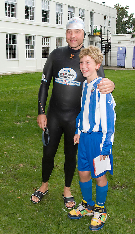© licensed to London News Pictures. London, UK.  10/09/2011. David Walliams poses for a photograph with a young fan before re-entering the River Thames at Monkey Island, Bray, Berkshire today (10/09/2011) on day 6 of his Sport Relief Challenge 'Wallians Vs The Thames'. Photo credit: Ben Cawthra/LNP