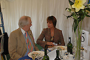Sir Tim Rice and Viscountess Windsor. Ludlow Charity Race Day,  in aid of Action Medical Research. Ludlow racecourse. 24 march 2005. ONE TIME USE ONLY - DO NOT ARCHIVE  © Copyright Photograph by Dafydd Jones 66 Stockwell Park Rd. London SW9 0DA Tel 020 7733 0108 www.dafjones.com