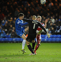 Bristol City's Wade Elliott challenges for the ball with Peterborough United's Robert Olejnik - Photo mandatory by-line: Dougie Allward/JMP - Mobile: 07966 386802 11/03/2014 - SPORT - FOOTBALL - Peterborough - London Road Stadium - Peterborough United v Bristol City - Sky Bet League One