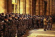 Dozens of policemen align to guard the entrance of Armenian Government building as a rally demanding the resignation of Armenia's Prime Minister Nikol Pashinyan marches outside PM's office in Yerevan, Armenia on Tuesday, Dec 15, 2020. Capital Yerevan has seen on-going protests since the November 9 ceasefire that was signed in Nagorno-Karabakh between Armenia, Russia, and Azerbaijan, an agreement that came into effect and resulted with Armenian troops withdrawal from the troubled region. (VXP Photo/ Vudi Xhymshiti)