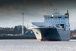 On the River Thames, a Ro-Ro cargo ship from the Cobelfret Ferries Line steams downriver.