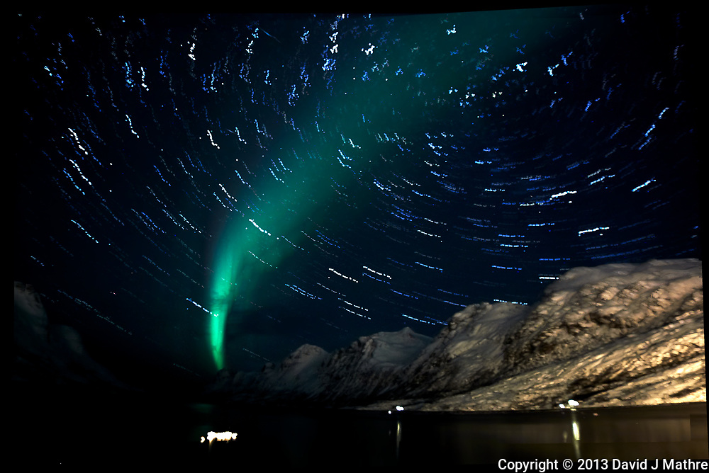 Star Trails. Chasing the Northern Lights. Ersfjord, Kvaløya (Whale Island). Composite of 23 images taken with a Nikon 1 V2 camera and 10 mm f/2.8 fisheye lens (ISO 1600, 16 mm, f/2.8, 15 sec).