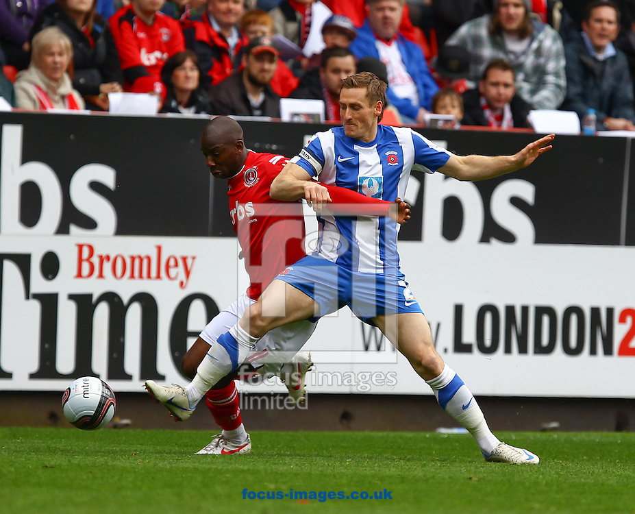 Picture by John Rainford/Focus Images Ltd. 07506 538356.05/05/12.Bradley Wright-Phillips of Charlton Athletic and Neil Austin of Hartlepool United during the Npower League 1 match at The Valley stadium, London.