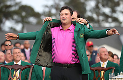 April 8, 2018 - Augusta, GA, USA - Patrick Reed is awarded the green jacket after winning the Masters at Augusta National Golf Club on Sunday, April 8, 2018, in Augusta, Ga. (Credit Image: © Jason Getz/TNS via ZUMA Wire)