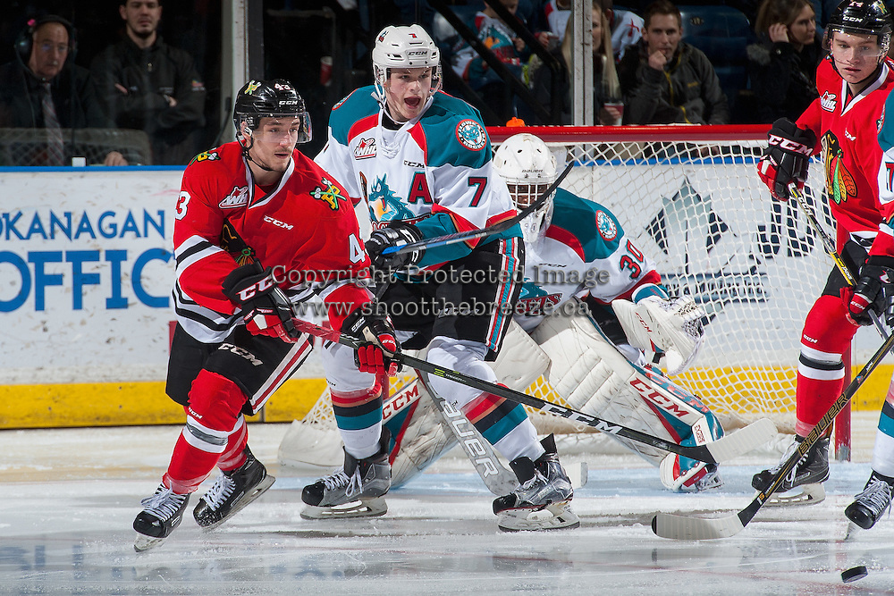 KELOWNA, CANADA - JANUARY 28: Skyler McKenzie #43 of the Portland Winterhawks looks for the pass in front of Lucas Johansen #7 and Michael Herringer #30 of the Kelowna Rockets on January 28, 2017 at Prospera Place in Kelowna, British Columbia, Canada.  (Photo by Marissa Baecker/Shoot the Breeze)  *** Local Caption ***