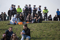 © Licensed to London News Pictures.  17/04/2021. London, UK. police patrol while members of the public making the most of the sunny weather in Primrose Hill, north London. Earlier this week Lockdown restrictions were eased to allow non essential retail and outdoor dining to reopen. Photo credit: Marcin Nowak/LNP