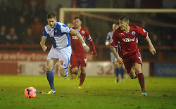 Bristol Rovers' Matt Harrold and Crawley Town's Kyle McFadzean chase after the ball - Photo mandatory by-line: Seb Daly/JMP - Tel: Mobile: 07966 386802 18/12/2013 - SPORT - FOOTBALL - Broadfield Stadium - Crawley - Crawley Town v Bristol Rovers - FA Cup - Replay