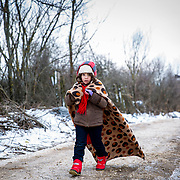 After crossing the Macedonian-Serbian border, a young refugee walks the unofficial refugee route in subfreezing snowy weather. Near Miratovac, Serbia, January 2016. <br /> <br /> According to UNHCR, 67,415 refugees landed in Greece in January 2016 alone, most of who traveled the route through Serbia on their way to Western Europe. The number of refugees arriving in Greece has dropped significantly since the Balkan border closures in March 2016.