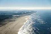 Nederland, Noord-Holland, Gemeente Schoorl, 11-12-2013; Petten, Hondsbossche en Pettemer Zeewering gezien vanuit Petten. naar het zuiden<br /> De dijk is aangelegd als zeewering nadat de oorsrponkelijke duinen weggeslagen waren. Door erosie kalven de duinen langs de kust steeds verder af, de dijk steekt daardoor steeds meer uit in zee.<br /> Hondsbossche and Pettemer seawall seen from the sea. The dike was built as a seawall after the primal dunes were washed away. Because of erosion the dunes decrease in size, therefore the sewall sticks more and more out into the sea.<br /> luchtfoto (toeslag op standard tarieven);<br /> aerial photo (additional fee required);<br /> copyright foto/photo Siebe Swart