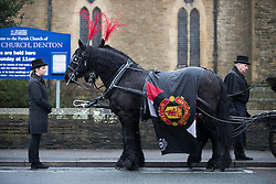 © Licensed to London News Pictures . 20/12/2017. Manchester, UK. A horse drawn hearse with Manchester United livery outside the church . The funeral of 14-year-old Sam Berkley at Christ Church in Denton , East Manchester . Mourners wear red and white , the colours of Hattersley FC , for whom Berkley played . Amongst their number are pupils and friends from Audenshaw School . Berkley died after being hit by a grey BMW near junction 3 of the M67 in Hyde , East Manchester , on 1st December 2017 . Photo credit: Joel Goodman/LNP