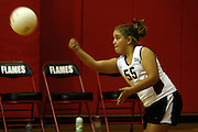 Elli Rose Focht serves the ball during a school volleyball game.