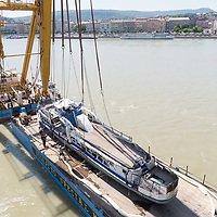Rescue personnel work on securing the passenger boat Hableany (means Mermaid in Hungarian) on another boat after it was lifted up from the river following it's capsize in an accident on river Danube in downtown Budapest, Hungary on June 11, 2019. ATTILA VOLGYI