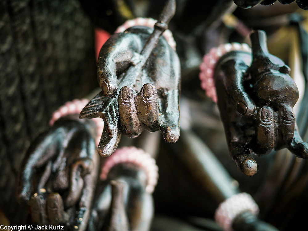 10 SEPTEMBER 2013 - BANGKOK, THAILAND:  The hands of a Buddha statue in a Chinese Shrine in Bangkok, Thailand.      PHOTO BY JACK KURTZ