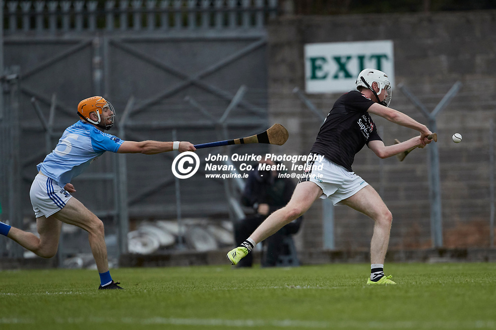 06-08-21, <br /> J2HC 2020 Final at Pairc Tailteann, Navan.<br /> Boardsmill v Dunderry<br /> Eric McKay (Boardsmill) cannot stop Adam Kelly as he nets the sliotar for Dunderry`s second goal<br /> Photo: David Mullen / www.quirke.ie ©John Quirke Photography, Proudstown Road Navan. Co. Meath. 046-9079044 / 087-2579454.<br /> ISO: 640; Shutter: 1/1250; Aperture: 4;