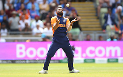 India's Mohammed Shami takes the wicket of England's Jos Buttler (not pictured) during the ICC Cricket World Cup group stage match at Edgbaston, Birmingham.