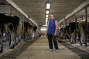"""""""I can't wait for just two weeks to go by so I can just take a deep breath,"""" said Joan Wortman the week after the sale of her cows. Wortman stands in her barn, now filled with Holsteins and Jerseys while helping transition operations to Matt Deome's Premier herd. (Valley News - James M. Patterson) Copyright Valley News. May not be reprinted or used online without permission. Send requests to permission@vnews.com."""