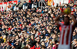 Stoke City fans watch a throw-in being taken
