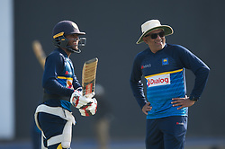 December 28, 2017 - Colombo, Western Province, Sri Lanka - Sri Lanka young batsman Kusal Mendis (L) and newly appointed head coach Chandika Hathurusingha (R) looking at some funny thing during the first practices session (Credit Image: © Sameera Peiris/Pacific Press via ZUMA Wire)