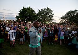 July 7, 2017 - Falcon Heights, MN, US - As people held up lanterns and cell phone flash lights Paster Danny Givens addressed the crowd at the Unity and peace event for Philando Castile Friday, July 7, 2017, at the Falcon Heights City Hall in Falcon Heights, MN. Looking on is Valerie Castile, Philando's mother, center,  and Allysza Castile, Philando's sister, left.]......DAVID JOLES • david.joles@startribune.com..........Unity & Peace Lantern Release (Credit Image: © David Joles/Minneapolis Star Tribune via ZUMA Wire)