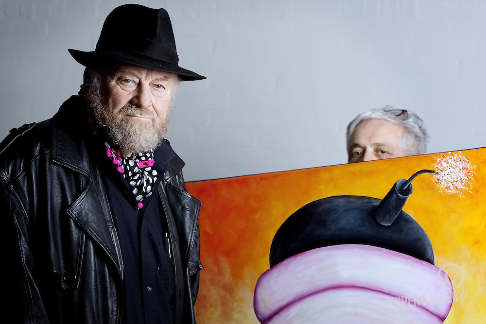 Europe, Denmark, Skanderborg, Kurt Westergaard at the gallery Gallery Draupner to do an interview with Henryk M. Broder. It is Henryk M. Broder that is holding the painting on the left. The painting is not made by Westergaard. 04.01.2011 © 2011 Jesper Balleby / Agentur Focus