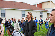 """Brad Pitt on a walking tour through the """" Make it Right """" houses in New Orleans Lower 9th Ward the day before a star-studded gala being held in New Orleans. Brad Pitt started the Make It Right Foundation after Hurricane Katriana destroyed large areas of the Lower 9th Ward."""