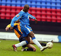 Photo: Chris Brunskill. Wigan Athletic v Milwall. Coca-Cola Championship. 12/03/2005. Jason Roberts scores the second goal of the game for Wigan.