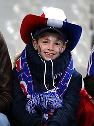 A young France fan shows his support prior to the International Friendly match at the Stade de France, Paris.