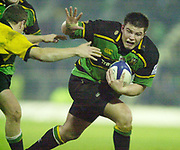Northampton, Northamptonshire, UK, 08.12.2001, Andy Rennick,  hands off a Wasp's defender as the Saints attack the Wasps line. during the, Northampton Saints vs  London Wasps, Zurich Premiership Rugby, Franklyn Gardens, [Mandatory Credit: Peter Spurrier/Intersport Images]