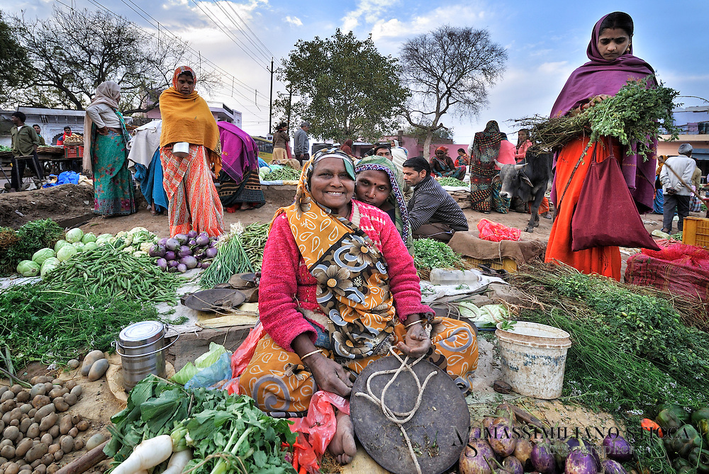 The market in the old town of Gwalior. A woman selling vegetables