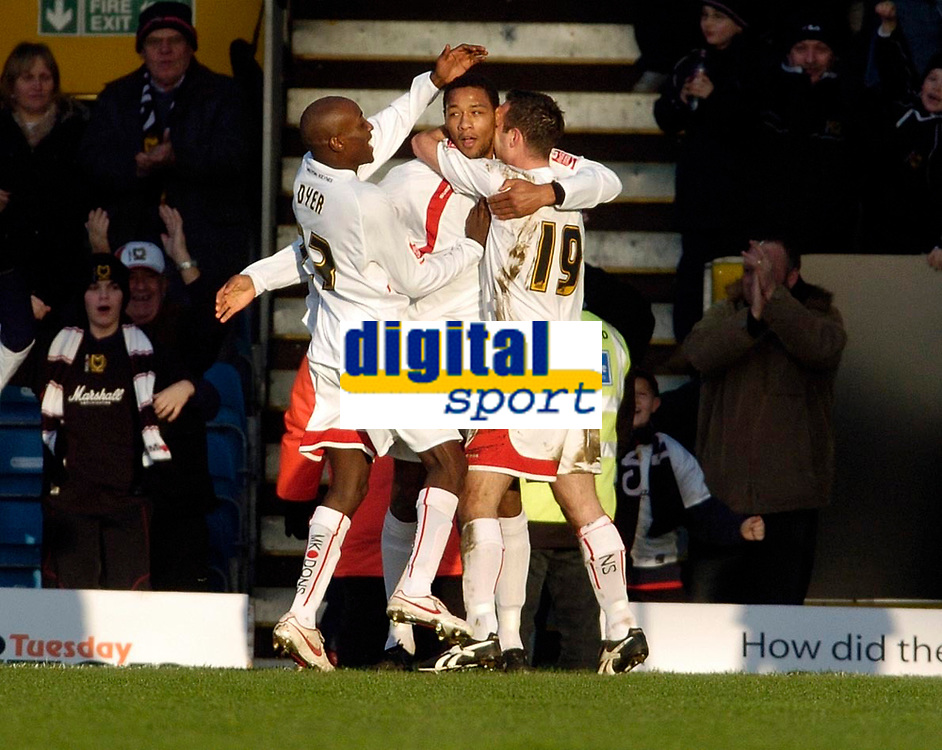 Photo: Leigh Quinnell.<br /> Milton Keynes Dons v Barnet. Coca Cola League 2. 20/01/2007. MK Dons Clive Platt(C) is congratulated on his goal by Lloyd Dyer(L) and Scott Taylor(R)