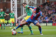 Jonathan Howson of Norwich City is intercepted by Jason Puncheon of Crystal Palace. Barclays Premier League match, Crystal Palace v Norwich city at Selhurst Park in London on Saturday 9th April 2016. pic by John Patrick Fletcher, Andrew Orchard sports photography.