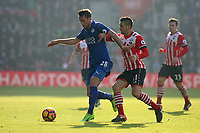 Football - 2016 / 2017 Premier League - Southampton vs. Leicester City<br /> <br /> Christian Fuchs of Leicester City holds Southampton's Dusan Tadic off the ball at St Mary's Stadium Southampton England<br /> <br /> COLORSPORT/SHAUN BOGGUST