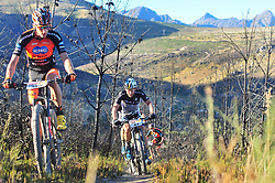 WELLINGTON SOUTH AFRICA - MARCH 23: Jordan Sarrou give's way for Karl Platt during stage five's 39km time trial on March 23, 2018 in Wellington, South Africa. Mountain bikers gather from around the world to compete in the 2018 ABSA Cape Epic, racing 8 days and 658km across the Western Cape with an accumulated 13 530m of climbing ascent, often referred to as the 'untamed race' the Cape Epic is said to be the toughest mountain bike event in the world. (Photo by Dino Lloyd)