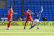 Cardiff City's Joe Ralls (8) is fouled by Nottingham Forest's Sammy Ameobi (11) during the EFL Sky Bet Championship match between Cardiff City and Nottingham Forest at the Cardiff City Stadium, Cardiff, Wales on 2 April 2021.