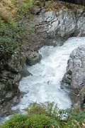 rapid flowing water as seen from the Wilde Wasser Weg (Wild water way) trail, Stubaital, Tyrol, Austria
