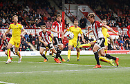 Rotherham United defender (and former Brighton player) Joe Mattock's brilliant tackle denies a very good chance to score during the Sky Bet Championship match between Brentford and Rotherham United at Griffin Park, London, England on 17 October 2015. Photo by Andy Walter.