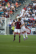 August 4, 2012: Colorado Rapids midfielder Brian Mullan (11) and Real Salt Lake defender Chris Wingert (17) both attempt to head the ball in the first half at Dick's Sporting Goods Park in Denver, Colorado