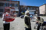 Josephine, centre with her niece, left, from Syria and Garnik, right, from Iraq; outside their homes in Darpnik, Armenia. After leaving their countries due to war, the three live in government provided housing. They express dissapointment in Armenia, their ancestral homeland.