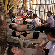 Asian tourists enjoy a massage on White Beach,  Boracay Island, the Philippines on September 29, 2008, Photo Tim Clayton..Asian tourists at White Beach, Boracay Island, the Philippines...The 4 km stretch of White beach on Boracay Island, the Philippines has been honoured as the best leisure destination in Asia beating popular destinations such as Bali in Indonesia and Sanya in China in a recent survey conducted by an International Travel Magazine with 2.2 million viewers taking part in the online poll...Last year, close to 600,000 visitors visited Boracay with South Korea providing 128,909 visitors followed by Japan, 35,294, USA, 13,362 and China 12,720...A popular destination for South Korean divers and honeymooners, Boracay is now attracting crowds of tourists from mainland China who are arriving in ever increasing numbers. In Asia, China has already overtaken Japan to become the largest source of outland travelers...Boracay's main attraction is 4 km of pristine powder fine white sand and the crystal clear azure water making it a popular destination for Scuba diving with nearly 20 dive centers along White beach. The stretch of shady palm trees separate the beach from the line of hotels, restaurants, bars and cafes. It's pulsating nightlife with the friendly locals make it increasingly popular with the asian tourists...The Boracay sailing boats provide endless tourist entertainment, particularly during the amazing sunsets when the silhouetted sails provide picture postcard scenes along the shoreline...Boracay Island is situated an hours flight from Manila and it's close proximity to South Korea, China, Taiwan and Japan means it is a growing destination for Asian tourists... By 2010, the island of Boracay expects to have 1,000,000 visitors.